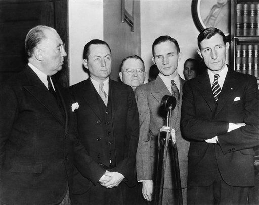 Bruno Richard Hauptmann, accused in the kidnap-killing of baby Charles A. Lindbergh, is shown above, on Jan. 3, 1935 with his attorneys at the end of the second day of his trial. Left to right are: Edward J. Reilly, Chief of Counsel; C. Lloyd Fisher and Frederick A. Pope, Assistants; Hauptmann, and Egbert Rosencrans, Assistant Counsel. Photo was made in the Hunterdon County Courthouse, Flemington, N.J. (AP Photo)