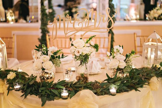 Green, gold and white winter wedding ceremony decor - lush green eucalyptus garland {Cesar Chavez Photography}
