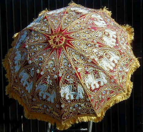 Large traditionally decorated umbrella for a traditional Indian wedding.