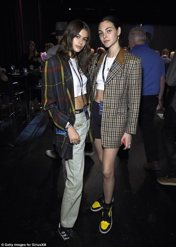 The 16-year-old looked effortlessly stylish in a white cropped t-shirt and tartan blazer while Italian mode Vittoria Ceretti also sported a