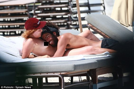 Everybody needs a bosom for a pillow: Noah Becker looked like he was following in his father's footsteps as he put on a steamy display with his topless girlfriend in Miami on Tuesday