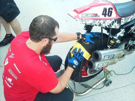 Veterans Empowered Through Motorsports crew member Dallas getting the #46 M.O.B. Racing Harley-Davidson XR1200 ready for Saturday afternoon Qualifying in AMA Pro Road Racing at Barber Motorsports Park.