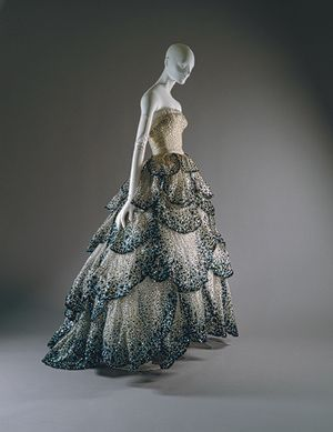 """""""Junon"""" dress, fall/winter 1949–50  Christian Dior (French, 1905–1957); Christian Dior Haute Couture (French, founded 1947)  Pale-blue silk net embroidered with iridescent blue, green, and rust sequins    Gift of Mrs. Byron C. Foy, 1953 (C.I.53.40.5a-e)  Not on view   Last Updated August 31, 2011    By 1949, Christian Dior's instinct for calibrated innovations of the body's """"line"""" had established him as fashion's preeminent arbiter. That year, dresses called """"Venus"""" and """"Junon,"""" or Hera to…"""