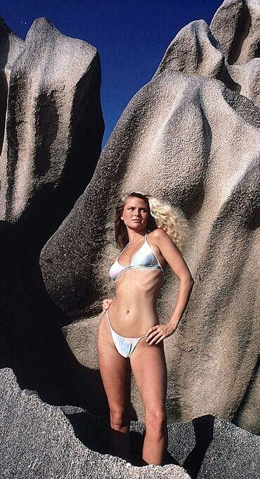 1979 Sports Illustrated Swimsuit. Photographed by Walter Iooss Jr.  Two sculptured forms, a wind-worn granite outcropping and Christie Brinkley,