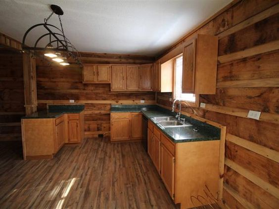 92,000 3bd/ 1baPrivate setting with 1.65 acres for this great cabin retreat Bath has been totally renovated with ceramic tile walled bathshower combo raindrop shower new vanity and fixtures. Log and sheetrock walls 2 good size bedrooms and a 3rd for a spare or study area. Nice size kitchen with open living area. Metal roof. Full basement walkout with large implement door. Covered full length rocking chair front porch. New wood look laminate throughout most of home.