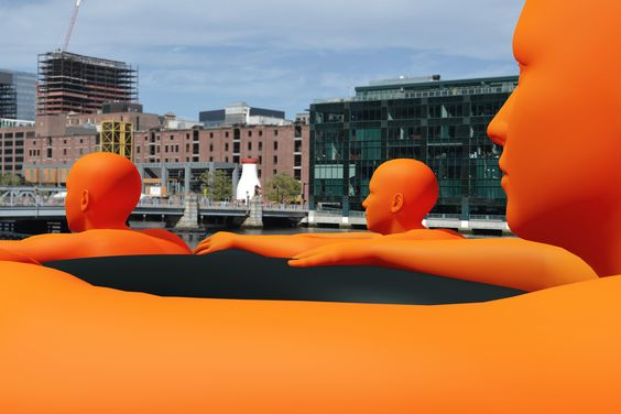 Public art in Boston via Ann Hirsch and Jeremy Angier's S.O.S. (Safety Orange Swimmers), 2016.COURTESY FORT POINT ARTS COMMUNITY