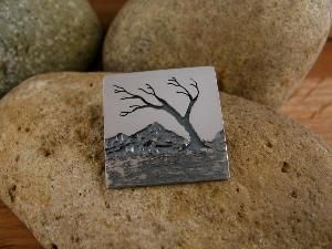 """Pendant says on the back, """"Be with the weather that arises."""""""