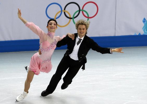 US Meryl Davis and US Charlie White perform in the Figure Skating Team Ice Dance Short Dance at the Iceberg Skating Palace during the Sochi Winter Olympics on February 8, 2014.  AFP PHOTO / ADRIAN DENNISADRIAN DENNIS/AFP/Getty Images