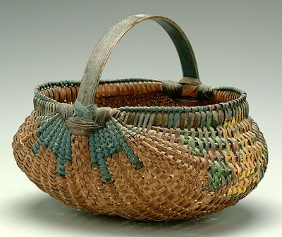 oak split egg basket, finely woven with blue, yellow, green, black and orange painted decoration
