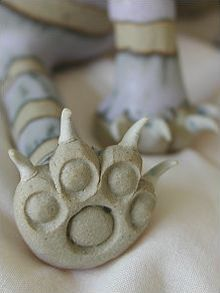 Attitude Cat - seated | hand-made pottery from Muggins Pottery in Leicestershire - wedding gifts, birthday presents, christening presents and anniversary gifts.