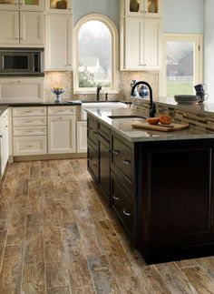 Love the look of wood but not the price? This may be a good option: porcelain tiles that come in many colors like pecan and cherry to weathered tan. They are durable, affordable and becoming a popular flooring trend.