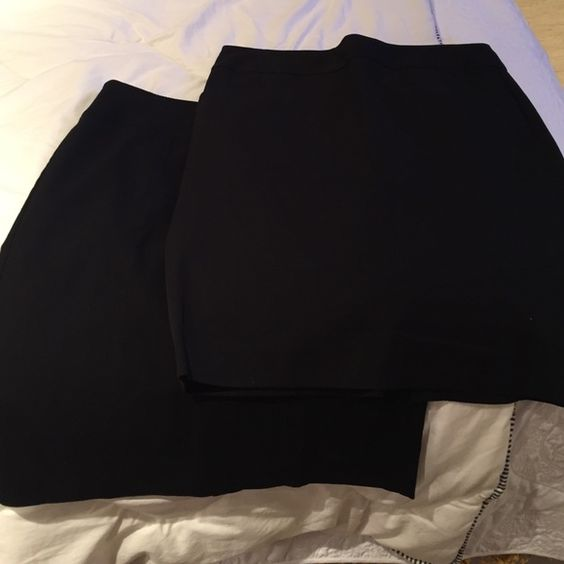 Bundle Pencil Skirts Bundle of 2 black pencil skirts. Perfect condition. Comfortable and classy. Banana Republic size 12 with small pockets and a 4 inch slit on the back. Bandolino size 12, no pockets with shorter slit in back. Has double stitching for - subtle flare. These are both stretch and would fit a 12-14. Skirts Pencil
