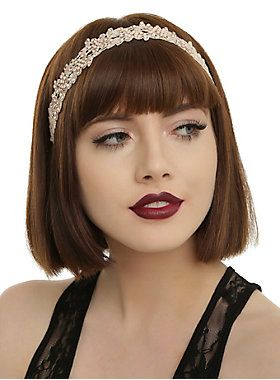 <p>Stretchy headband with gem accented ivory floral detailing.</p>  <ul> 	<li>Imported</li> </ul>