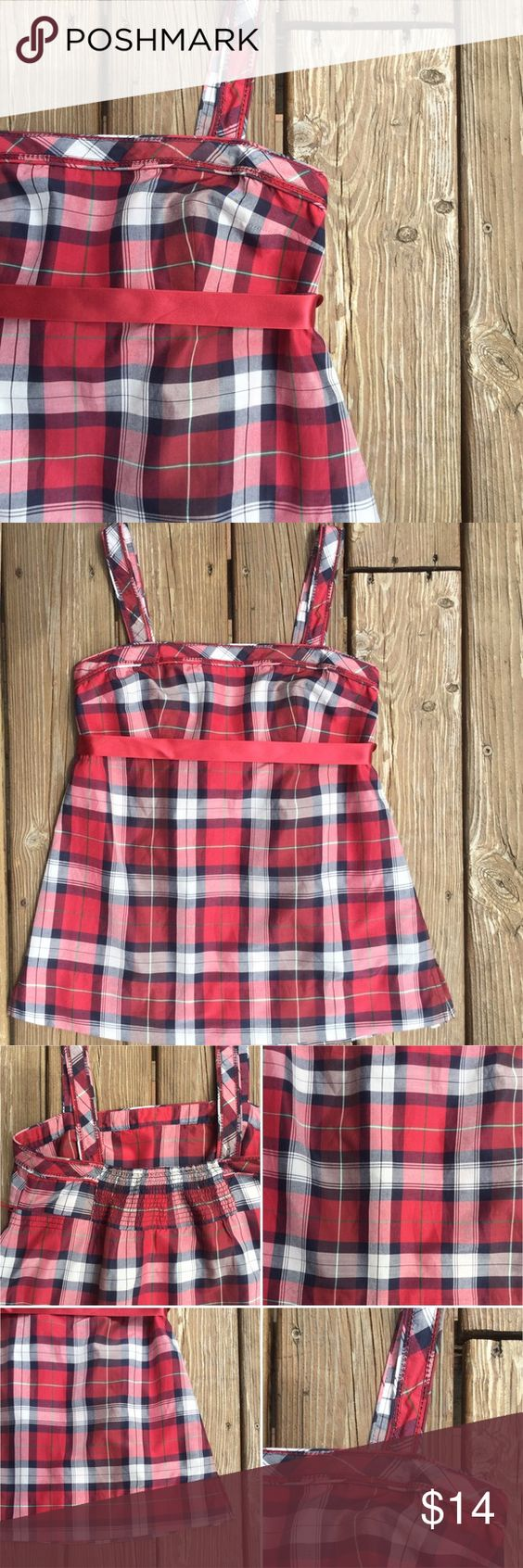"""AMERICAN EAGLE Plaid Empire Tank w/Ribben Tie Cool and light as air 61% Cotton/39% Silk adjustable 1"""" strap, empire waist blouse. Trendy red, white and navy plaid. Smocked gathering in the back. Side vents at hem. App. measurements: Waist - 15.5"""" from armpit to armpit; Length - 20"""" drop from top band to hem measuring down the front, (not including straps). American Eagle Outfitters Tops Tank Tops"""