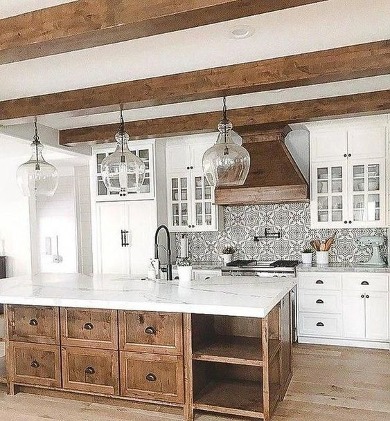 Beautiful beams, backsplash tile, white cabinets, wooden island #homedesignideas