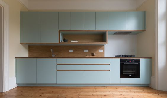 Similar shape & size to ours. I like the colour & handles. Corian worktop looks good. Don't like the wood splash backs. Well hidden fan & the cooker would look better like this as cleaner line without one full height. Not sure how spice cupboard idea would fit... One above & below?...