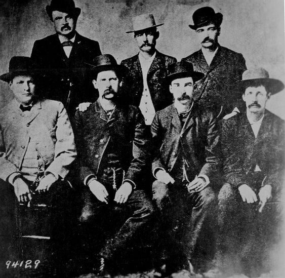 "Dodge City Law Officers - L to R: Chas. Bassett, W. H. Harris, Wyatt Earp, Luke Short, L. McLean, Bat Masterson, Neal Brown."" By Camillus S. Fly, ca. 1890"
