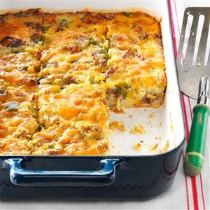 Holiday Brunch Casserole Recipe -If you'll be having overnight company during the holidays, you may want to consider this hearty casserole. Guests will be impressed with its bountiful filling and scrumptious flavor. —Nelda Cronbaugh, Belle Plaine, Iowa