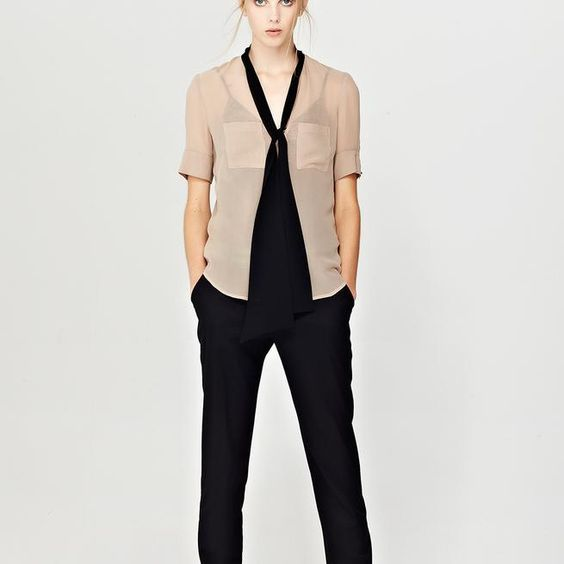 The Agnes shirt features a V-neck with contrast sash which can be worn tied or left open and hanging, cuffed short sleeves and anasymmetrical patch pocket.