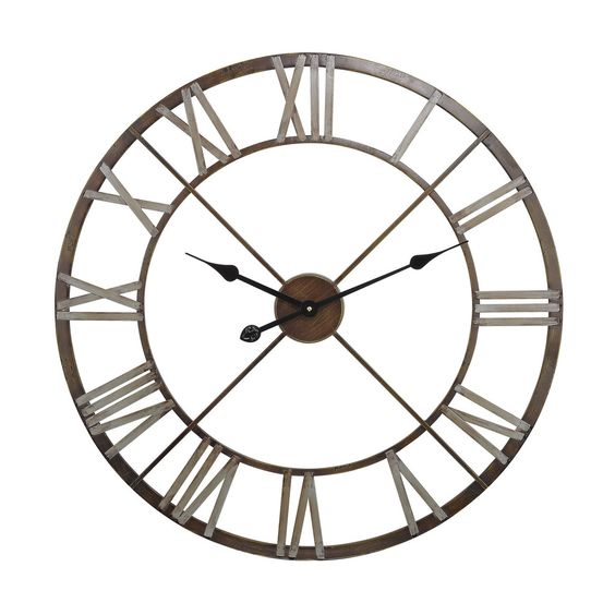 This wall clock features an open center with Roman numerals in relief around the edge allowing the background color of the wall behind to show through https://joyfulhomegoods.com/collections/wall-decor/products/sterling-industries-open-center-iron-wall-clock-171-012?variant=20311304071 Free gift for our Pinterest fans! $5 gift card, use code PIN5 to redeem!
