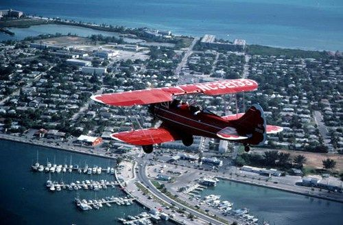 Freddy Cabanas in his Waco bi-plane over Key West by State Library and Archives of Florida