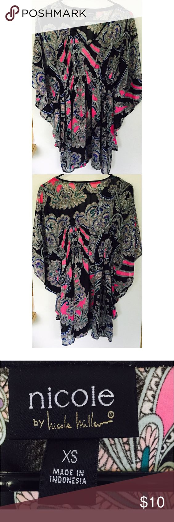 Nicole Miller multi color flowy blouse Excellent condition. Very pretty and comfortable top. It's an xs but fits anywhere from xs to med fit. All depends on how flowy you like your tops. Colors in the blouse are black, purple, magenta, teal, royal blue and white Nicole by Nicole Miller Tops Blouses