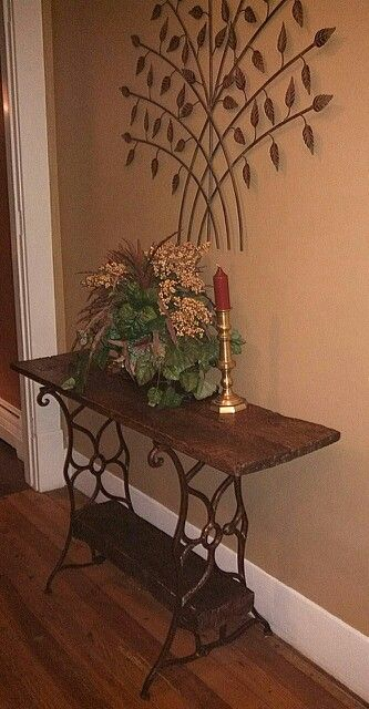 Foyer table made from antique sewing machine legs and barn board. I need to do this with my Grandma Mollie's sewing machine... very special item.