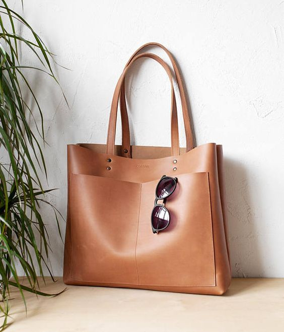Matte Tan high quality genuine Italian leather . Bag is very roomy and comfortable. Can be used as daily bag, shopper, travel, school bag. Durable double straps. Perfect to carry many things: Laptop, magazines, books, ipad, and more... Fits 15 mackbook pro Size: Height: 33cm (13) Width at