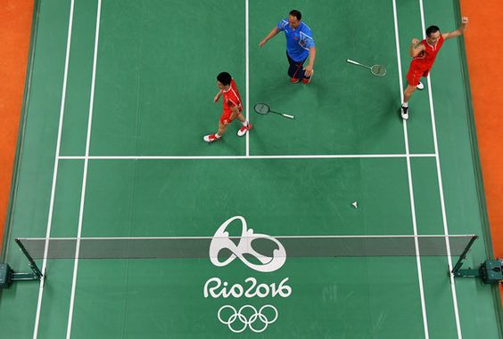 Nan Zhang and Haifeng Fu of China celebrate match point against Wee Kiong Tan and Shem V Goh of Malaysia during the Men's Badminton Doubles Gold Medal Match on Day 14 of the Rio 2016 Olympic Games at Riocentro - Pavilion 4 on August 19, 2016 in Rio de Janeiro, Brazil.