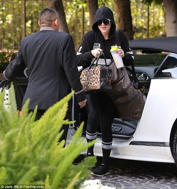 What's in the luggage?:The 30-year-old Kardashian had two heavy bags in her hands as she ...