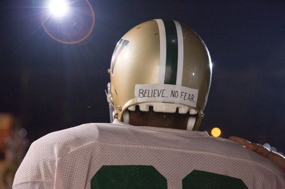 Woodlawn Movie. The back of his helmet reads: BELIEVE. NO FEAR. I currently have that Sharpied on the back of my hand. I am committed. No fear.: