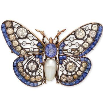 A SAPPHIRE, DIAMOND AND CULTURED PEARL BUTTERFLY BROOCH. The openwork butterfly set with a cultured pearl and oval-cut sapphire body, with old mine-cut diamond eyes, extending calibré-cut sapphire and old European-cut diamonds and light brown diamonds, mounted in silver and pink gold.