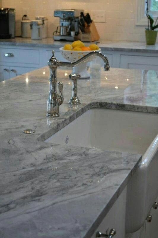 Quartz counter tops are easier to care for and clean. It is also very durable for those with children. A mixture of light grey .. #KitchenCountertopsQuarts