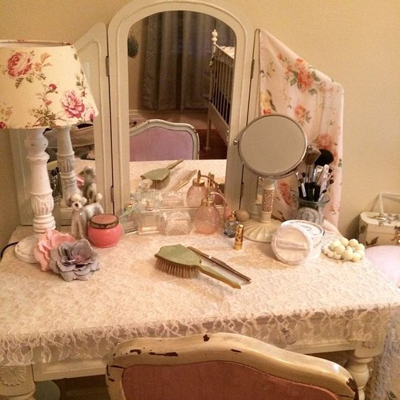 Just adore my vanity with all of my vintage trinkets. It's my favorite place for a morning cup of tea and some quality makeup time. #vintage #vanity #makeup #kitsch #poodle #atomizer #bakelite #besamecosmetics