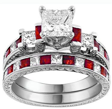 I'm in LOVE!!!! Perfect since my birthstone is Ruby.....I think it's time for a new set! ;):