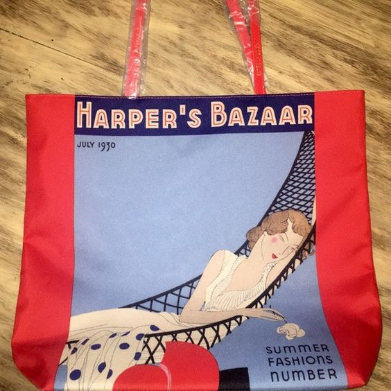 1930s-Inspired Large Tote Brand new, never used large bag. Works as a purse, book bag, or beach bag. Says Harper's Bazaar across the top. Says Summers Fashion Number at the bottom corner. And says July 1930 on top corner. Bright red leather straps. Estee Lauder Bags Totes