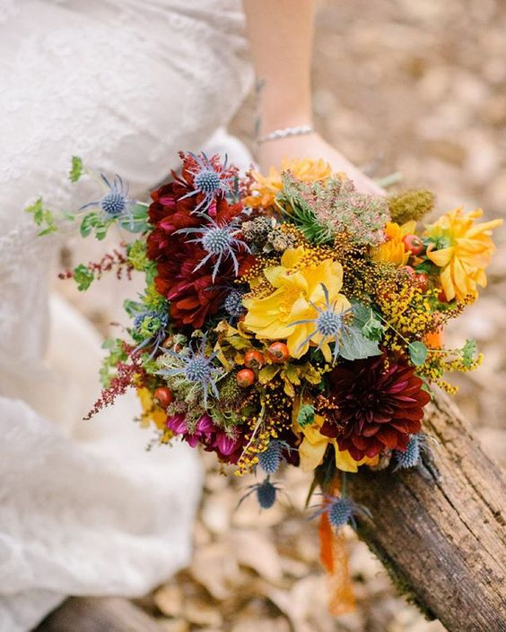 """Having a fall wedding? This yellow + burgundy bouquet is perfect for the occasion!  #theknot  via @brittrenephoto 