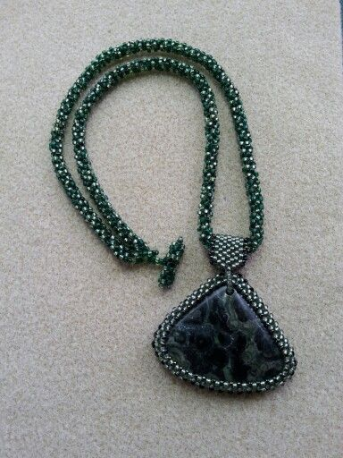 Kambaba jasper in a right angle weave bezel a peyote bail, and a faux-cubic right angle weave necklace.