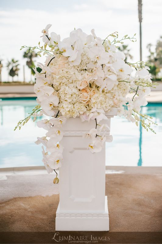 Large White Floral Arrangement On Pillar We Could Also Have Starfish On Sticks In The Bouquet
