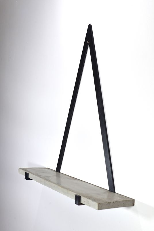 The Concrete Triangle Shelf is a beautiful and simple item which we are thrilled to have in our store. This elegant design would be perfect as a centre point of any room with a selection of styled home accessories adorning the shelf. The polished handmade concrete shelf combined with the gunmetal black is a really great mixture of materials.   -The Concrete Triangle Shelf is rather heavy so would have to be hung from a solid wall.