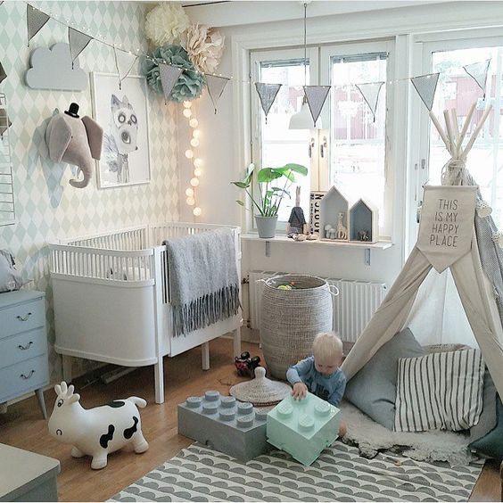 Cluttered wall, teepee sign, house shelves, bunting