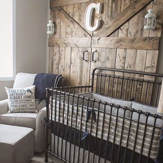 This barn door accent wall just takes this rustic baby boy nursery up a notch. Love, love!: