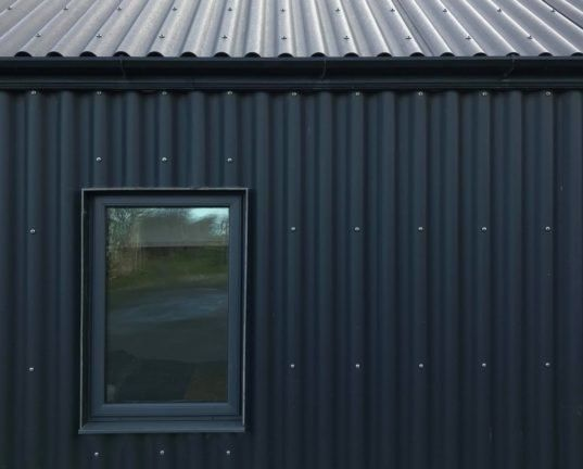 Metal Clad Eco Cottage Puts A Modern Spin On Irish Rural Architecture Rural Architecture Green Building Architecture Architecture