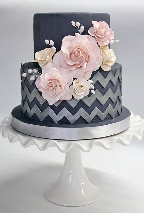http://Brides.com: 22 Wedding Cakes for Dark, Modern Color Palettes. A Chevron Wedding Cake With Pink Flowers. Oversized pale pink sugar flowers offset the navy blue and silver chevron pattern on the bottom tier of this Coco Paloma Desserts fondant wedding cake. We love the contrast between sharp and soft elements—it's perfect for a modern wedding. See more modern wedding cakes. (Best Wedding and Engagement rings at http://www.brilliance.com)