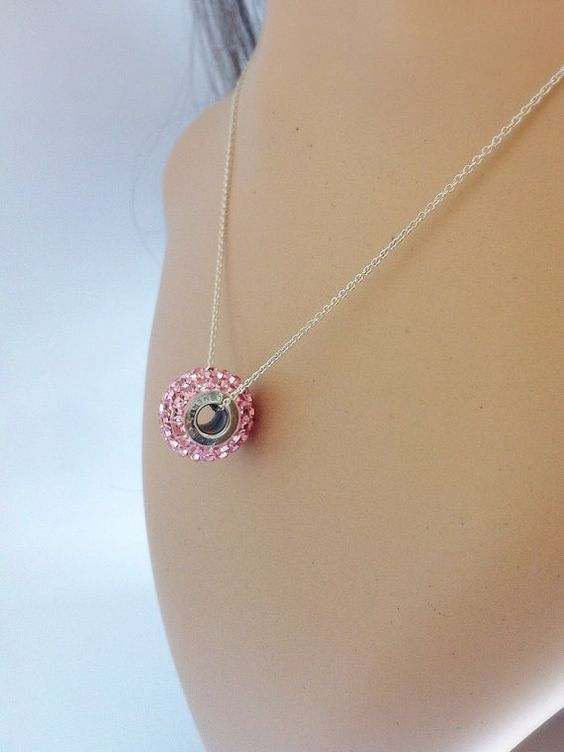 Silver necklace with a pink Swarovski becharmed bead by Bleuberie, $34.00