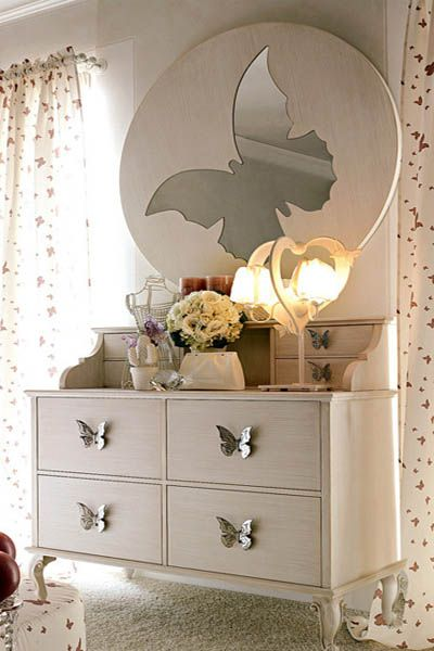 third bedroom theme: butterflies. as a guest room. for when my stepmom comes to visit. there will be a sideways drawer in hers though. and when she opens it, the door to a hidden walk-in closet will be revealed.