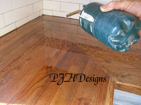 my kitchen remodel diy butcher block countertops, countertops, kitchens, Apply heat to remove bubbles in poly