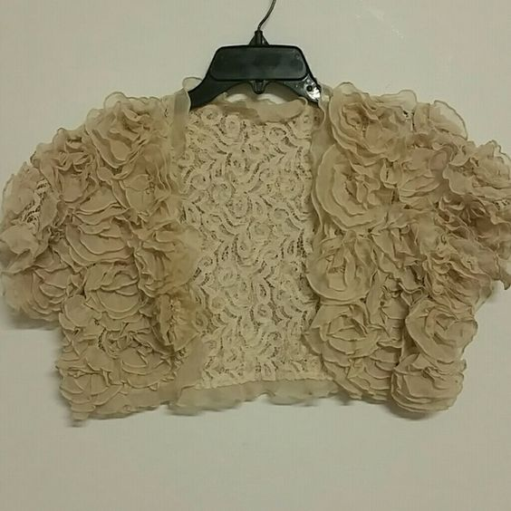 Lace bolero shrug Lace . I belive flowers are organza poly blend .  Tan beige great paired with a tank and  jeans Jackets & Coats
