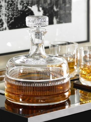 Ralph Lauren Home: this Broughton Decanter is one for the decadent among you - not only does it boast a body of crystal, its art deco touch gives it a really retro feel that will chime perfectly with a set of matching tumblers for your drink.