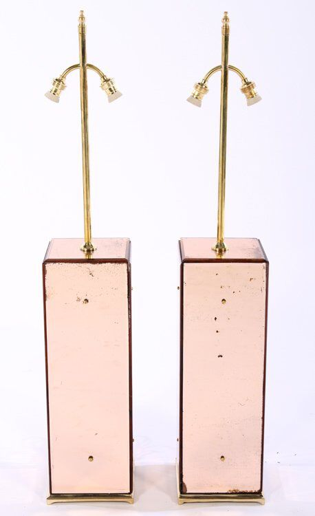 I just discovered this PAIR PINK MIRROR & BRONZE TABLE LAMPS C.1950 on LiveAuctioneers and wanted to share it with you: www.liveauctioneers.com/item/44187273